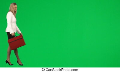Businesswoman waiting against a green screen