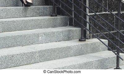 Businesswoman walking down building steps - Crop woman in...
