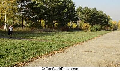 Businesswoman walking in autumn