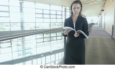 businesswoman walking in office building Slow motion