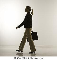 Businesswoman walking.