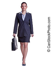Businesswoman walking with briefcase