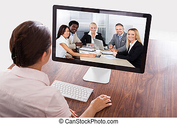 Businesswoman Watching An Online Presentation -...