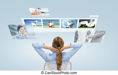 businesswoman watching video media files