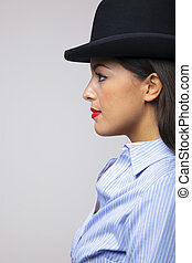 Businesswoman wearing a bowler hat.