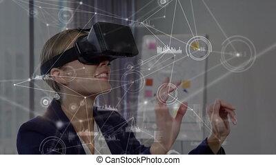 Businesswoman wearing a virtual reality headset