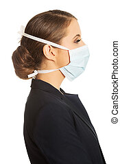 Businesswoman wearing doctor mask