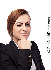 Businesswoman winking - Closeup of young confident ...