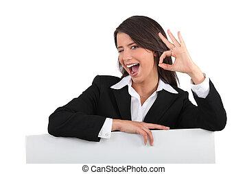 Businesswoman winking