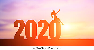 silhouette of business woman thumb up with 2020