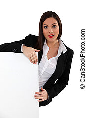 Businesswoman with a board left blank for your message