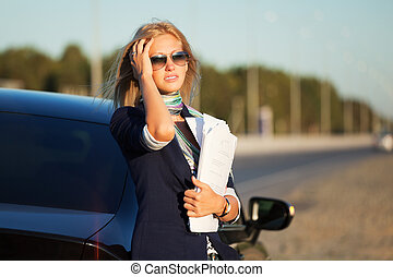 Businesswoman with a car