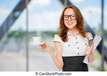 businesswoman with a cup of coffee in the office