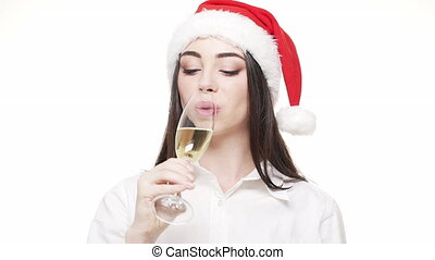 Businesswoman with a glass of champagne giving a toast celebrates for Christmas day