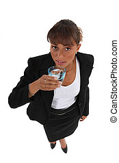 Businesswoman with a glass of water