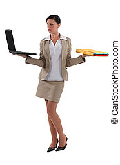 Businesswoman with a laptop and folder