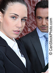 Businesswoman with a male colleague