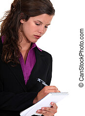Businesswoman with a notepad