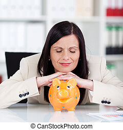 Businesswoman with a piggy bank