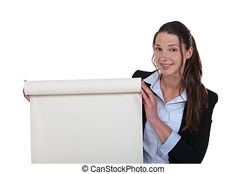 Businesswoman with a roll of blank paper