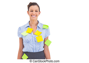 Businesswoman with adhesive notes