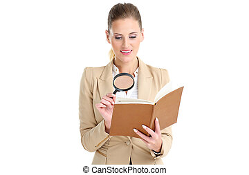 Businesswoman with agenda and magnifying glass