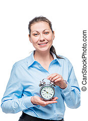 Businesswoman with alarm clock on white background in studio isolated
