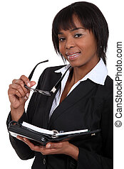 Businesswoman with an open diary