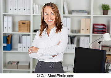 Businesswoman With Arms Crossed Looking Away