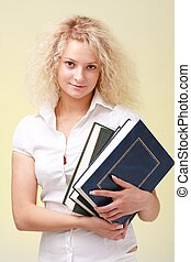Businesswoman with big books