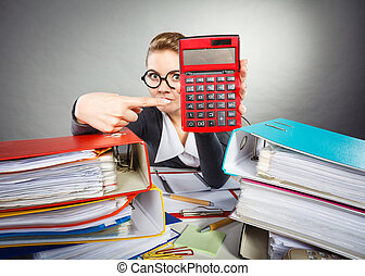Businesswoman with big red calculator.