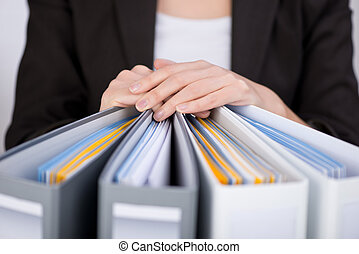Businesswoman With Binders - Midsection of businesswoman...