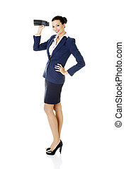 Businesswoman with binoculars.