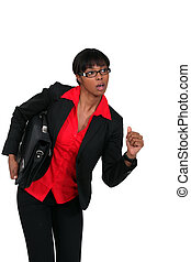 Businesswoman with briefcase about to run