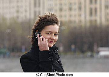 Businesswoman with cellphone in city