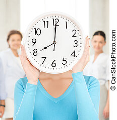 businesswoman with clock over her face - picture of...