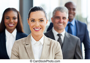 businesswoman with co-workers - cute businesswoman standing...