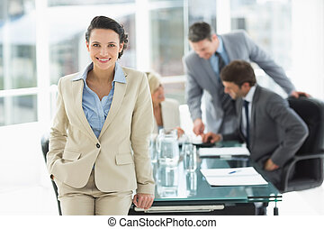 Businesswoman with colleagues discussing in office
