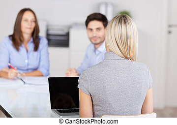 Businesswoman With Colleagues In Meeting At Conference Desk