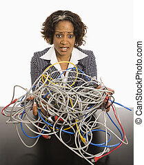 Businesswoman with computer cords.