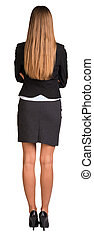 Businesswoman with crossed arms. Rear view. Isolated on...