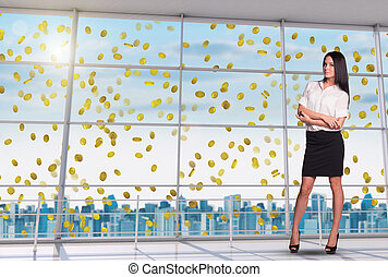 Businesswoman with crossed arms under money rain