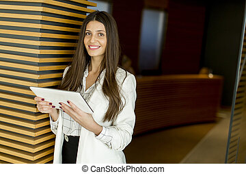 Businesswoman with digital tablet in the office