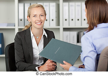 Businesswoman With Female Candidate In Office - Portrait of ...