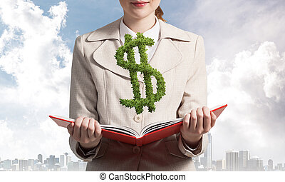 Businesswoman with green plant shaped dollar