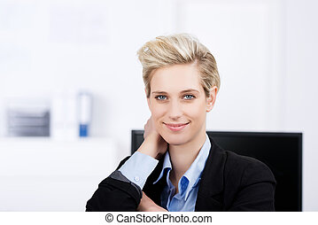 Businesswoman With Hand Behind Head