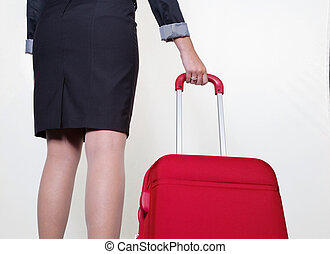 businesswoman with hand luggage