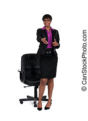 Businesswoman with hand stretched out