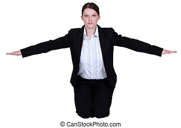 Businesswoman with her arms out