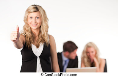 businesswoman with her thumb up to camera
